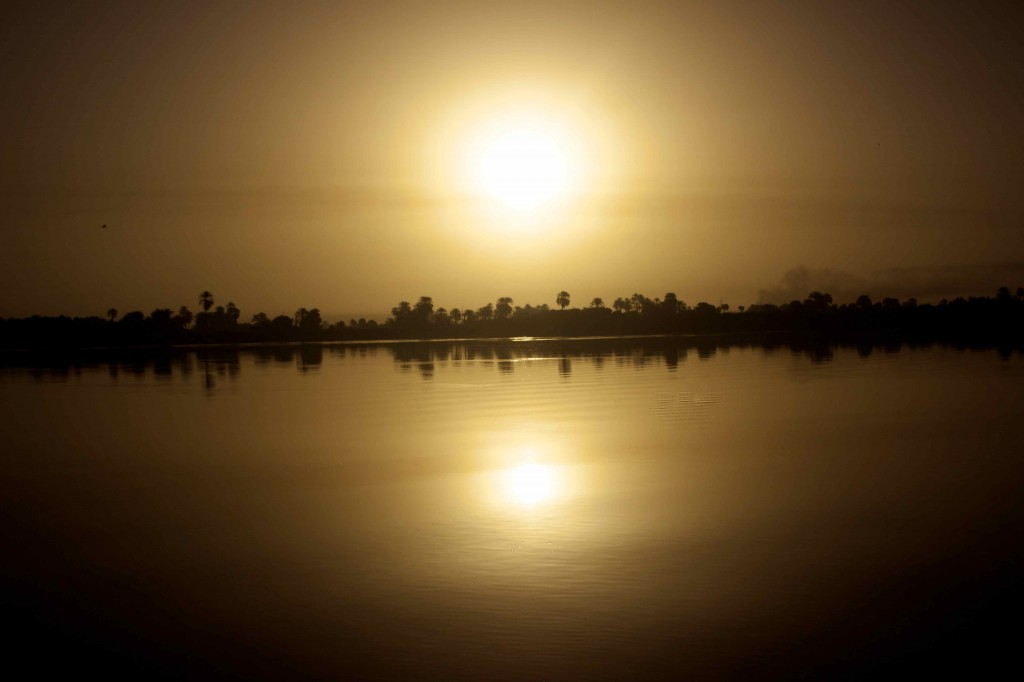 The sun setting over the Nile.