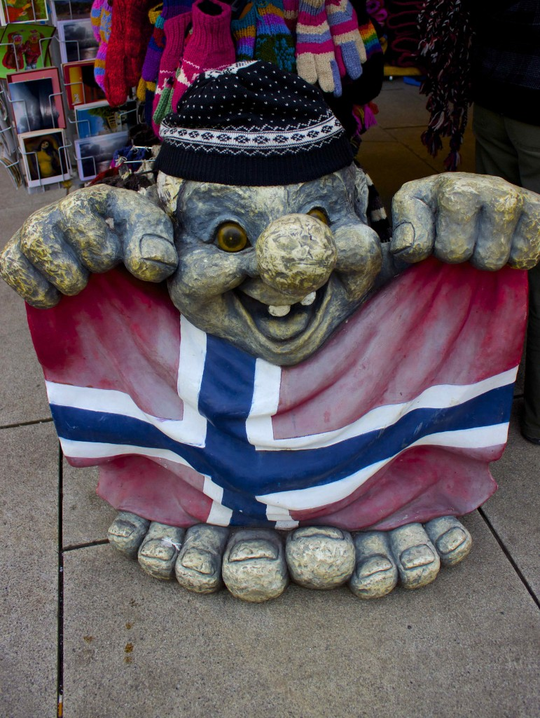 A troll holding up the Norwegian Flag.