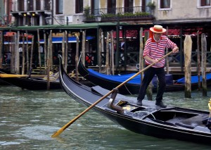 A gondolier wearing a red uniform.