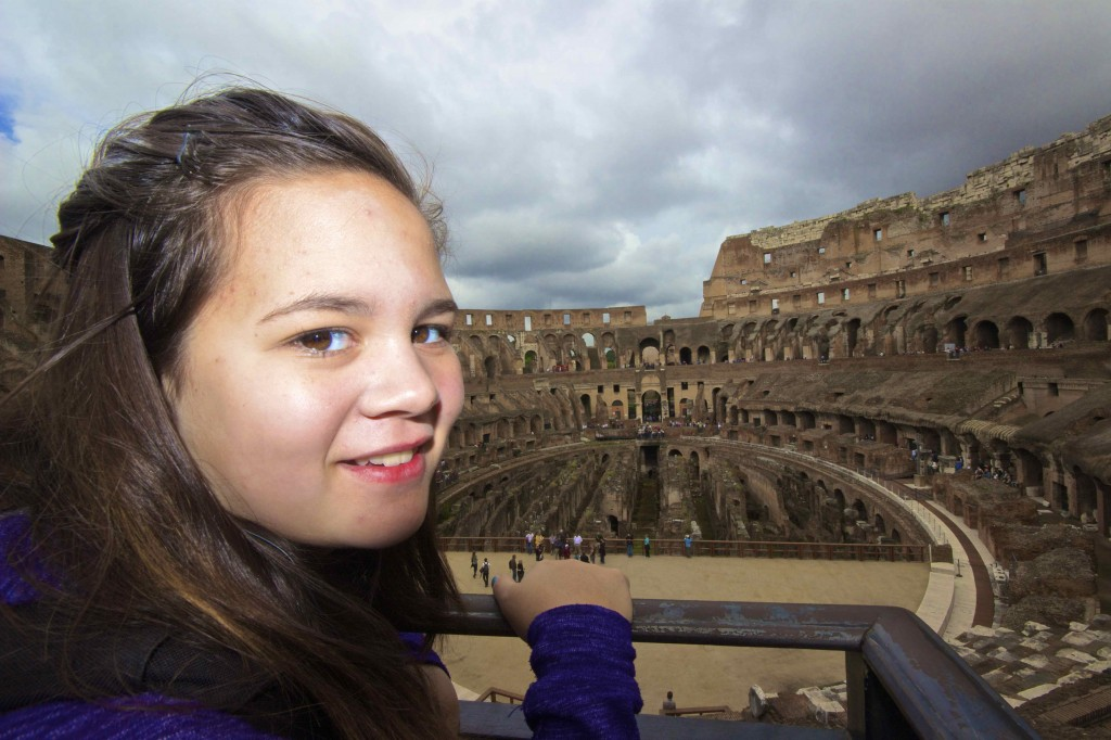 Meadhbh peering to the Colosseum.