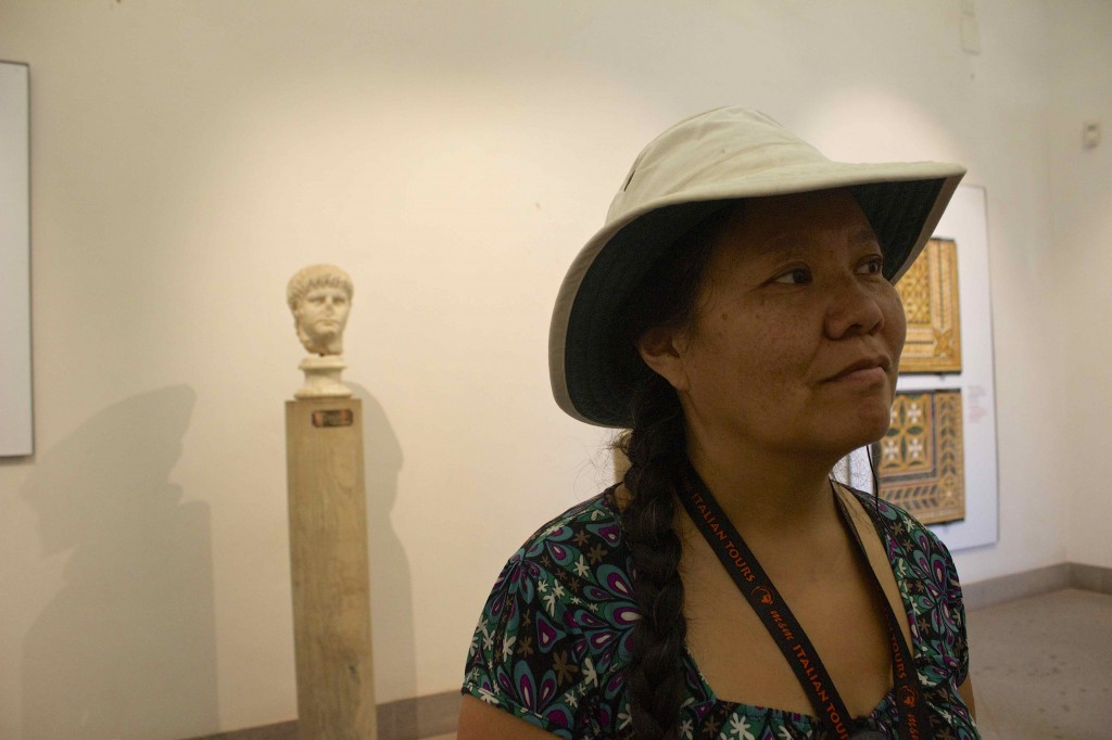 Wanda listening to our guide in the museum.