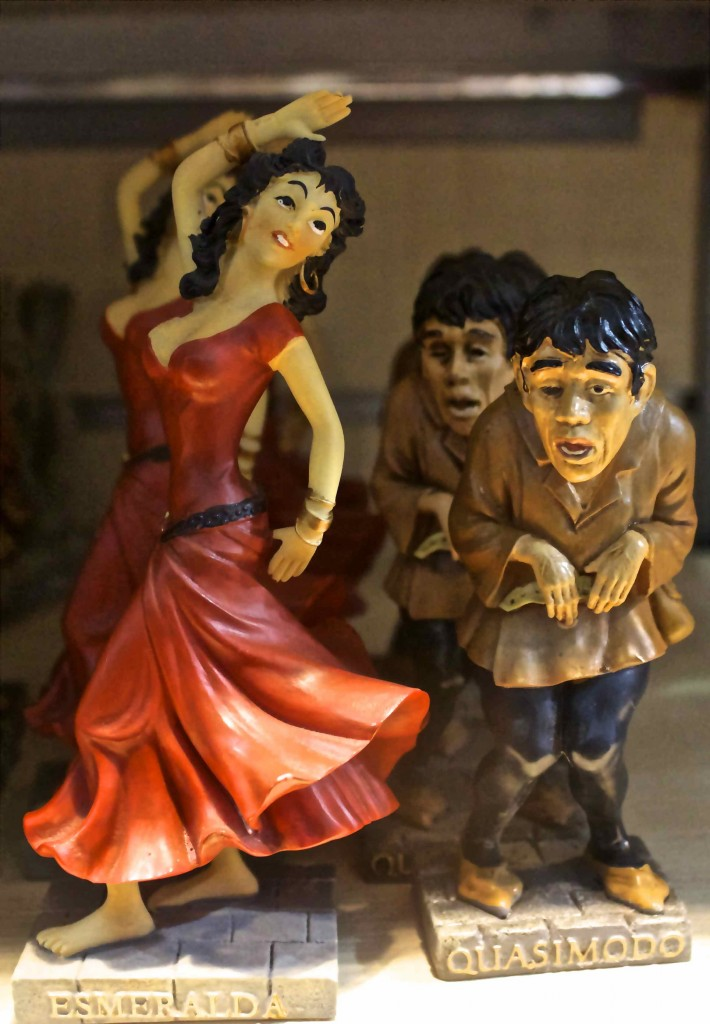 Quasimodo and Esmeralda figurines in a nearby shop.