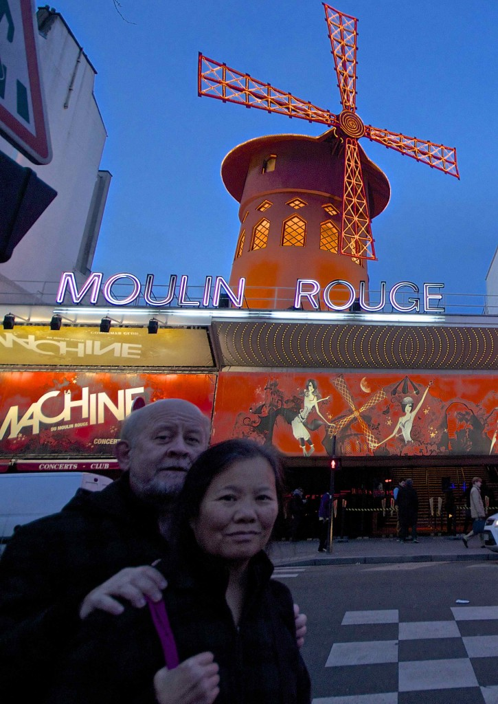 Seamus and Wanda outside the Moulin Rouge's famous windmill.