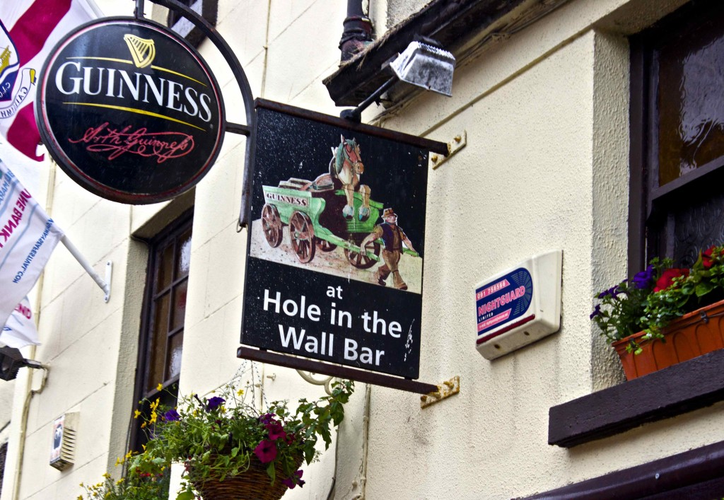 The sign for the Hole in the Wall Bar.
